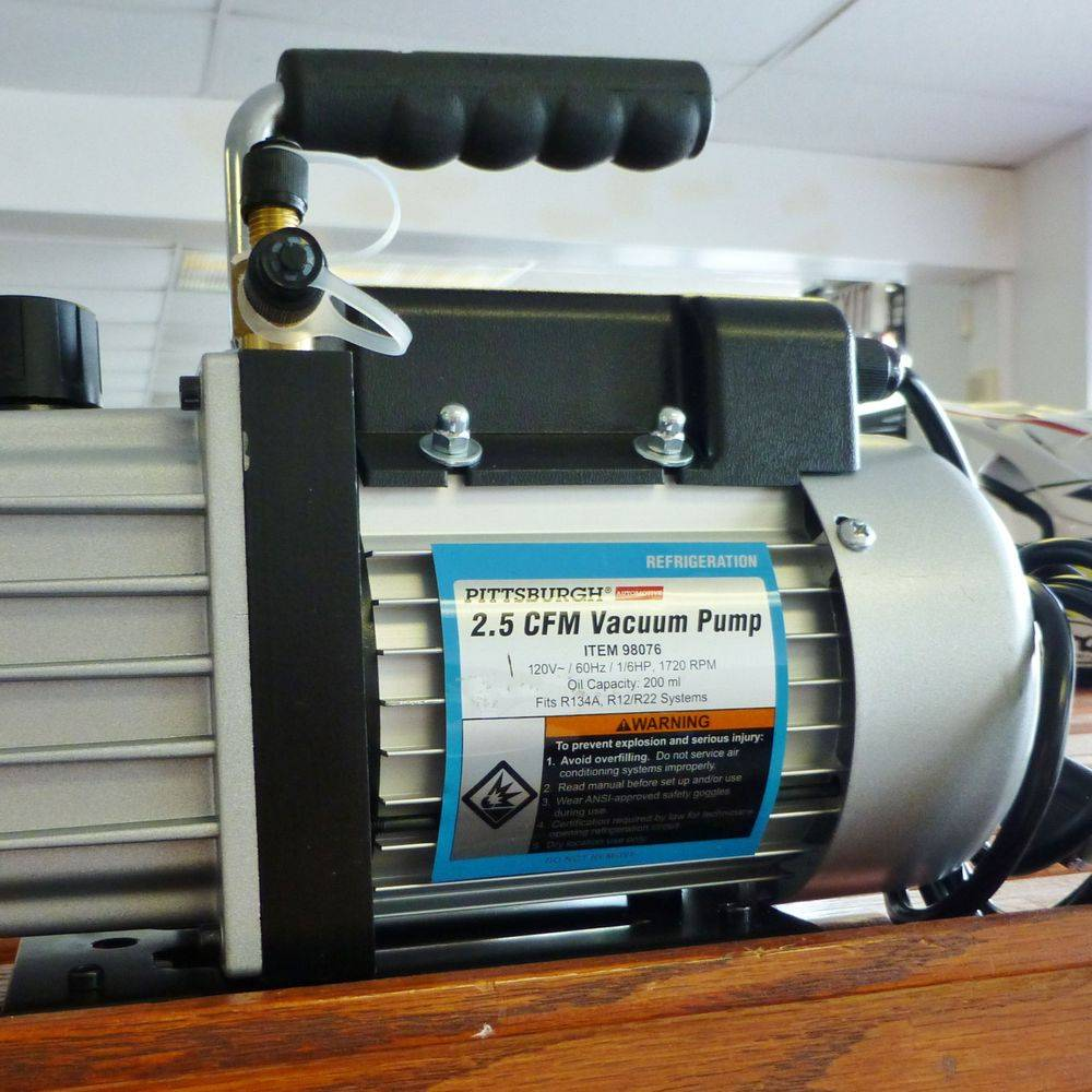 closeup picture of a pittsburgh vacuum pump on a wooden shelf