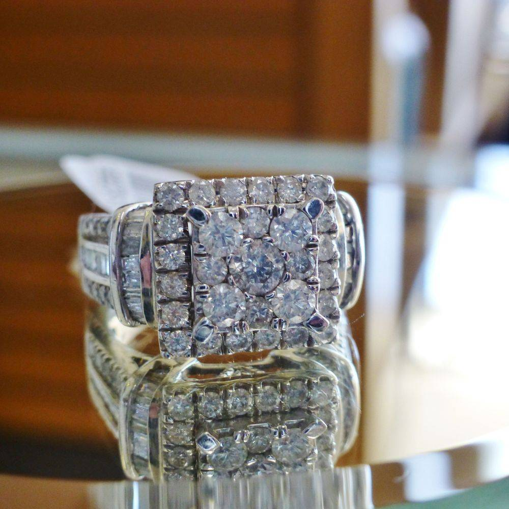 close up picture of a round cut composite diamond double square frame white gold engagement ring