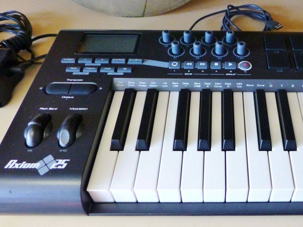 MIDI keyboard controller sitting on a wooden shelf