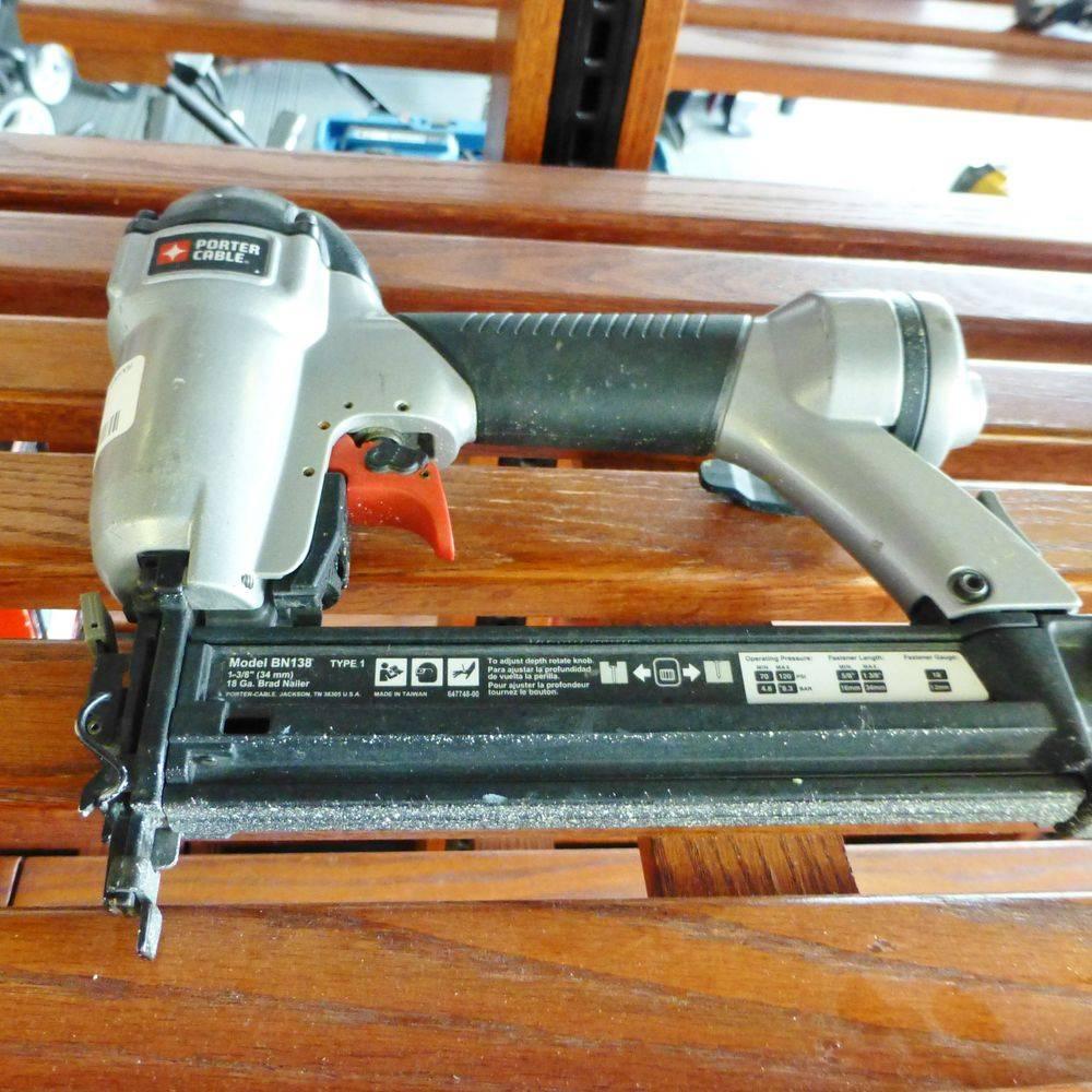 Brad Nail Gun on wooden slatted shelves