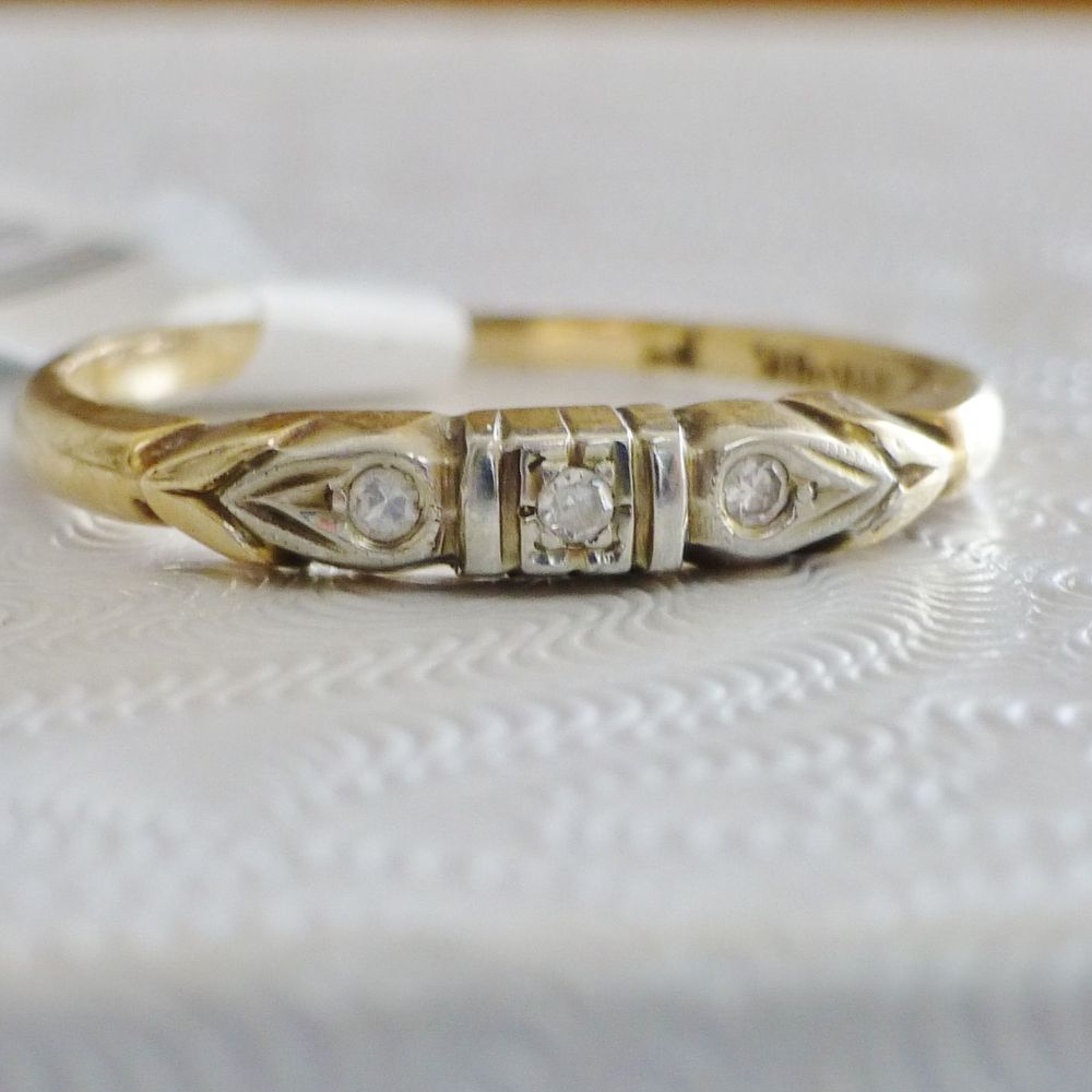 close up picture of an Art Deco yellow and white gold diamond chip band