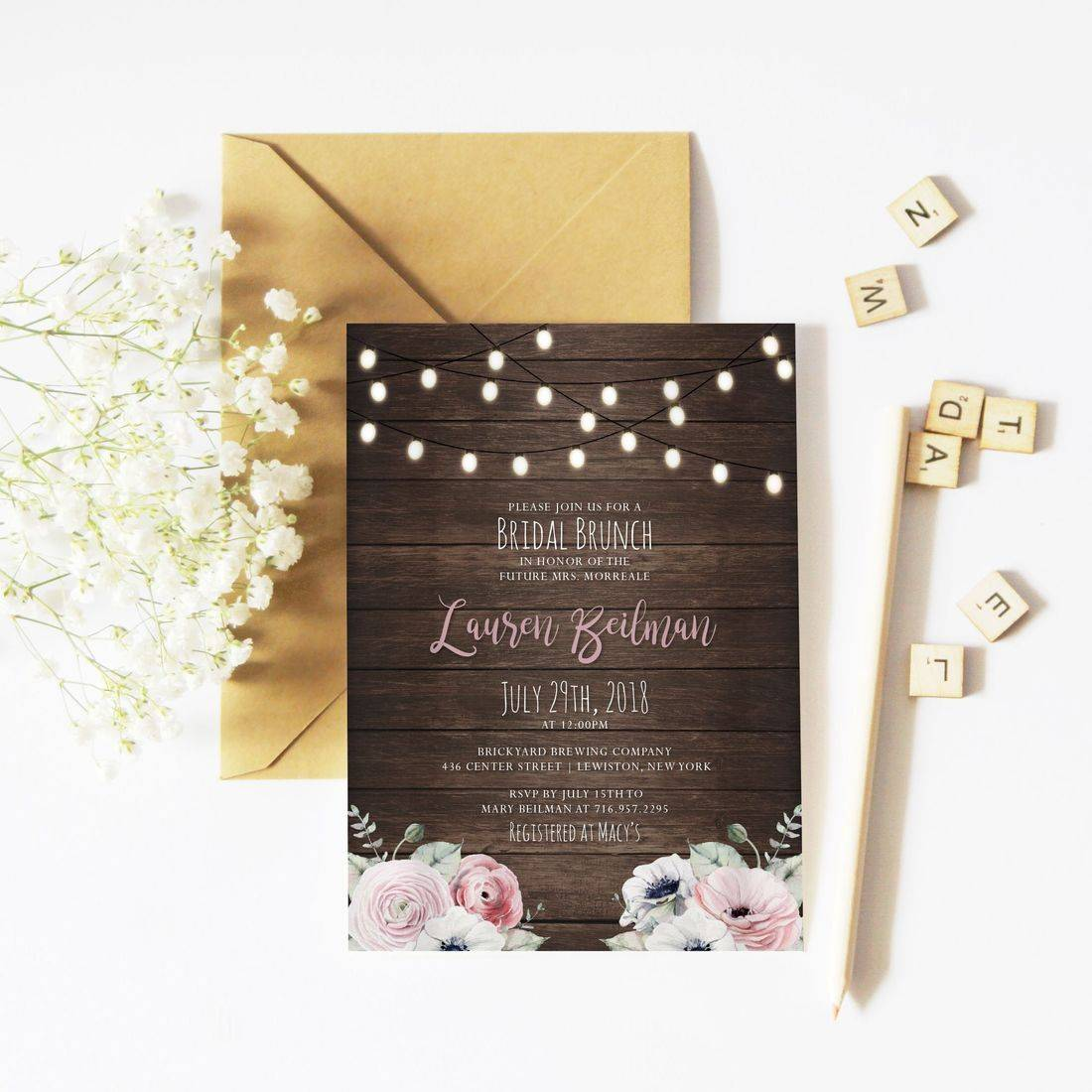 Rustic bridal shower invitation flat lay with string lights and flowers