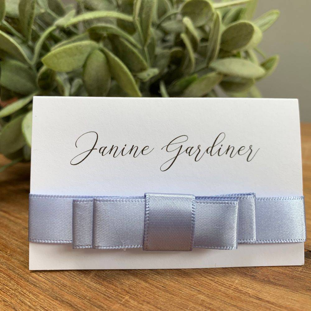 white and dusky blue wedding place name
