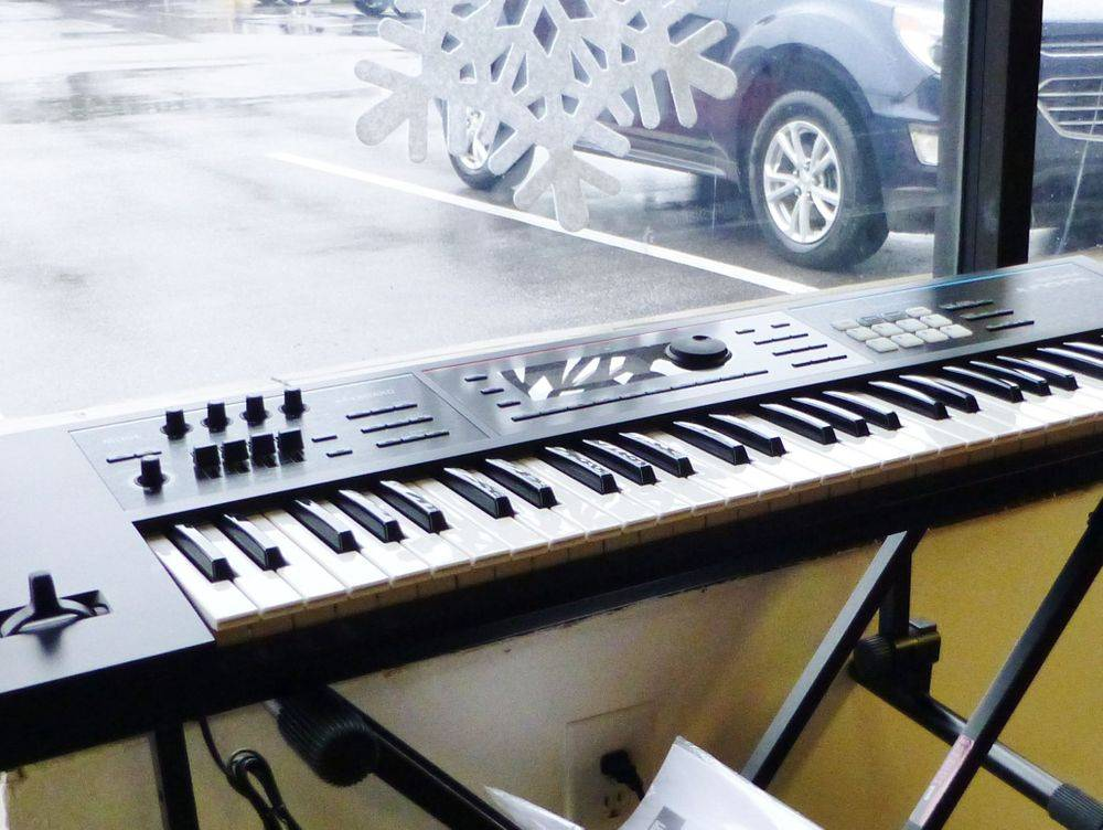 Close up picture of a Roland Juno DS 61 Key Synthesizer on a stand