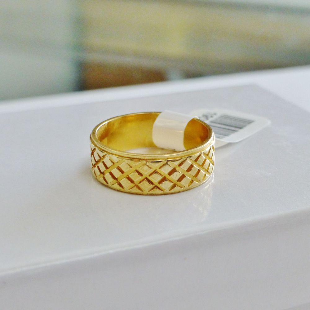 Closeup Picture of a Yellow Gold Ladies Diamond Cut Wide Band Wedding Ring