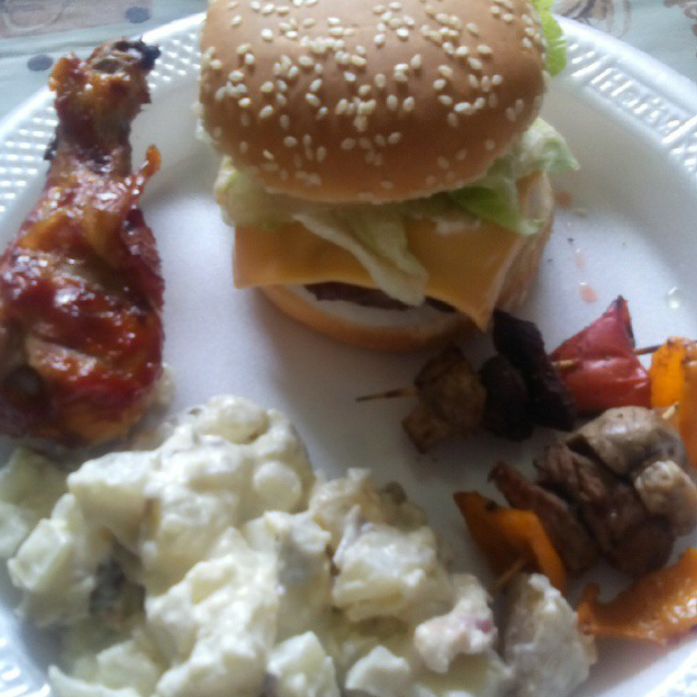 Burger, bbq drumstick, potato salad, veggie skewers