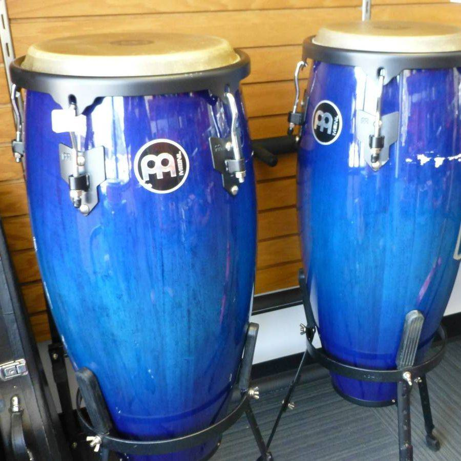 Two Blue Bongo Drums On Black Stands