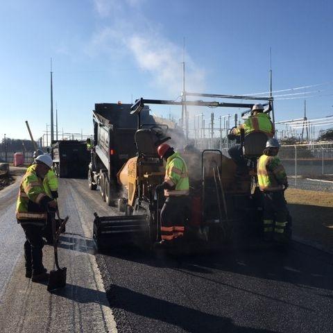 crew installing asphalt