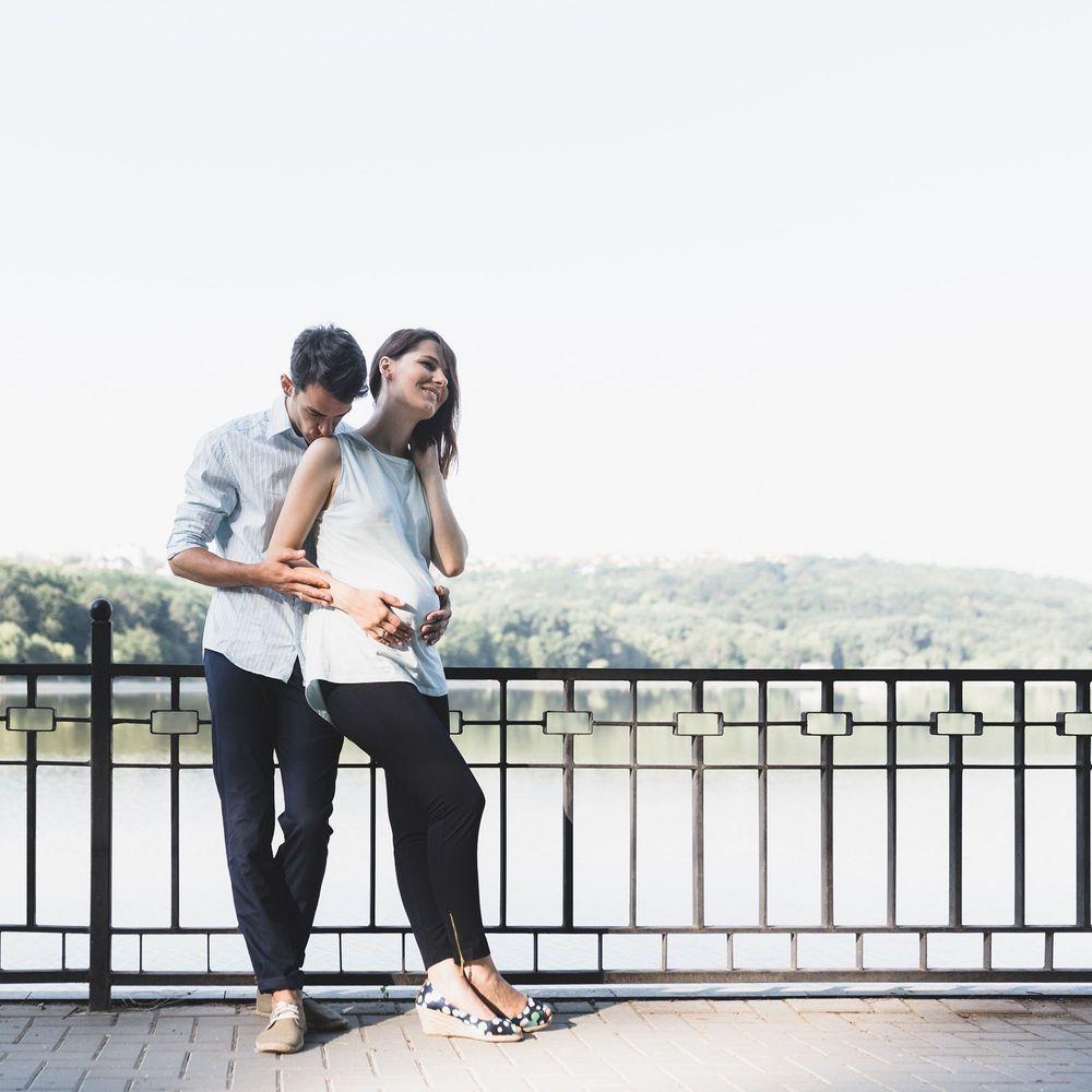 couple standing by river