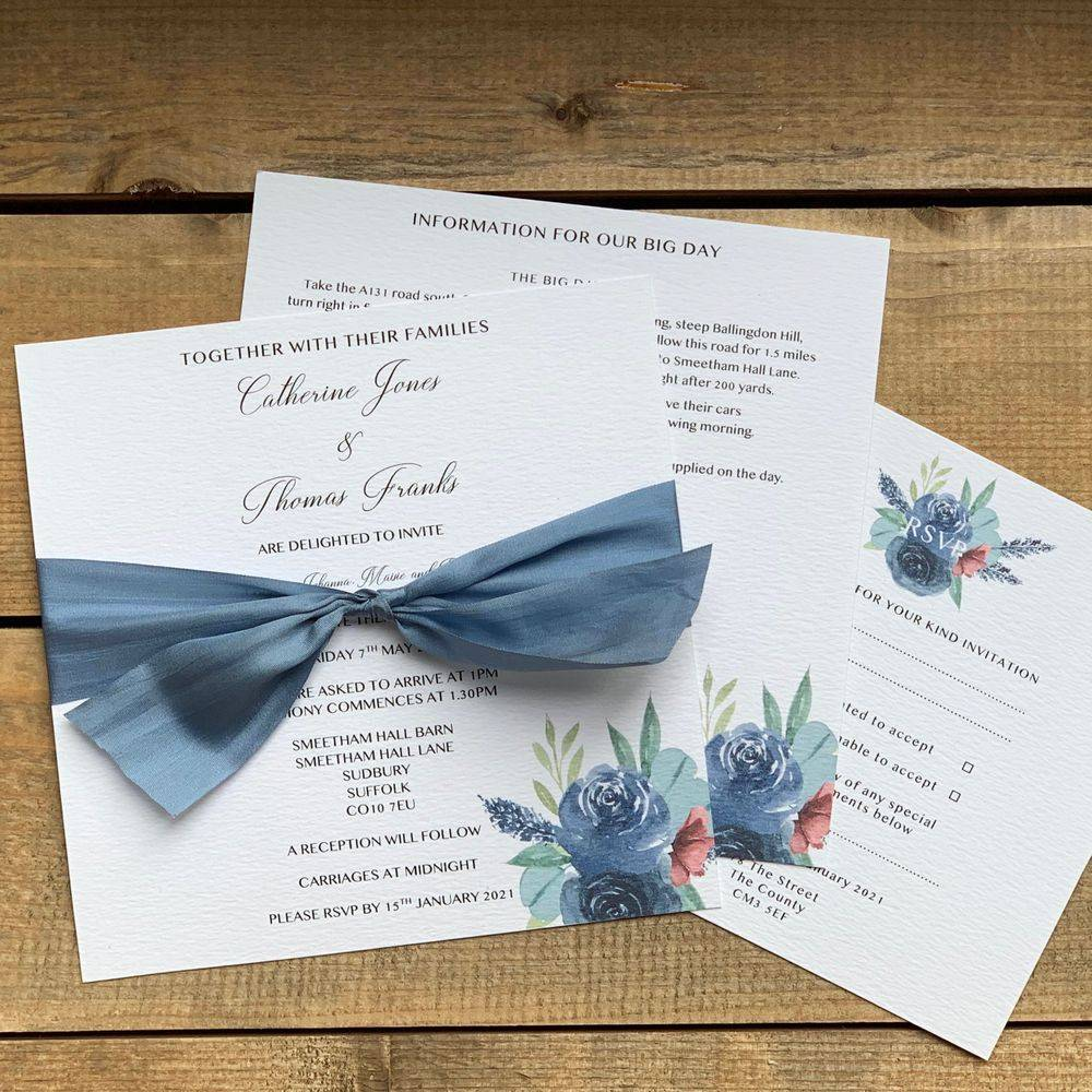 Luxury  wedding invitation in white with slate blue silk ribbon