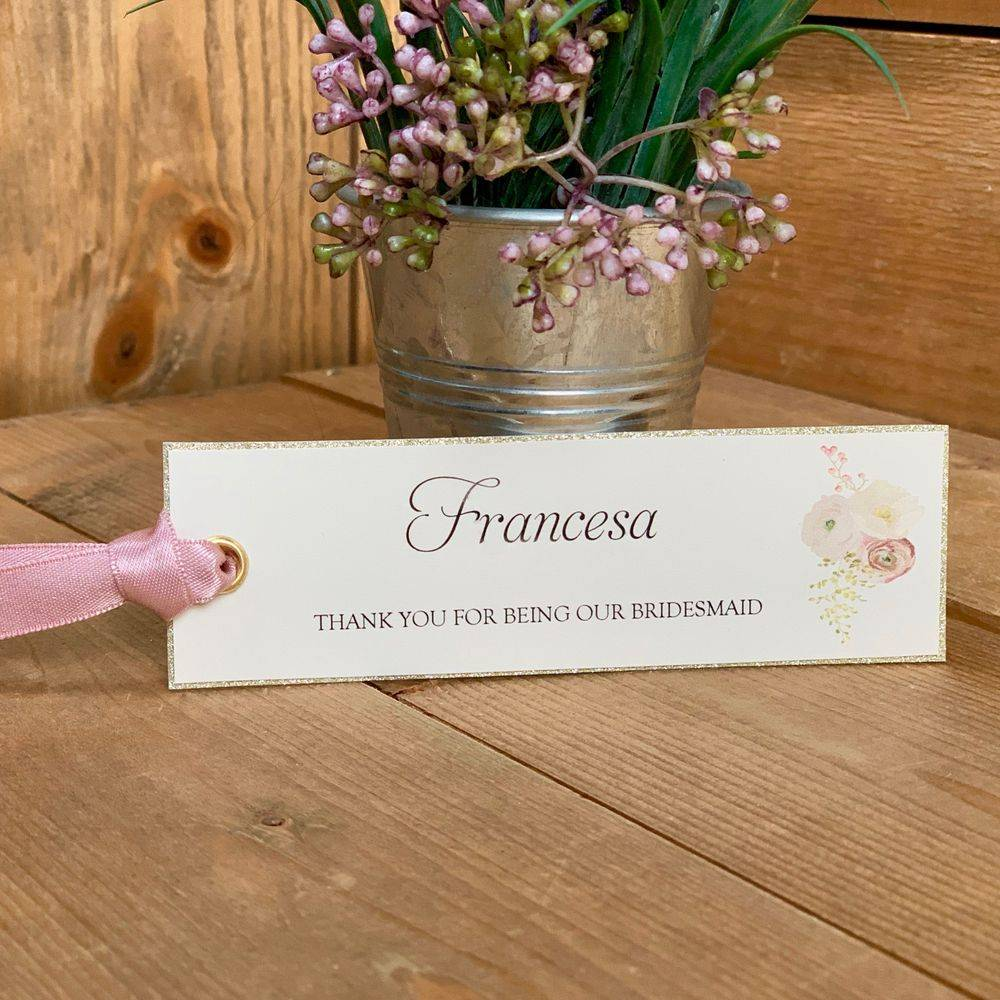 Wedding gift tags - Printed with name of recipient and personal message of thanks. Punched with gold rivet and decorated with rose ribbon