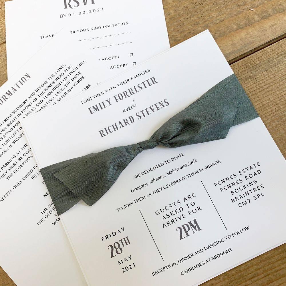 White wedding invitation with slate grey silk ribbon