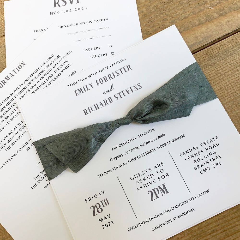 White wedding invitation with slate grey silk ribbon