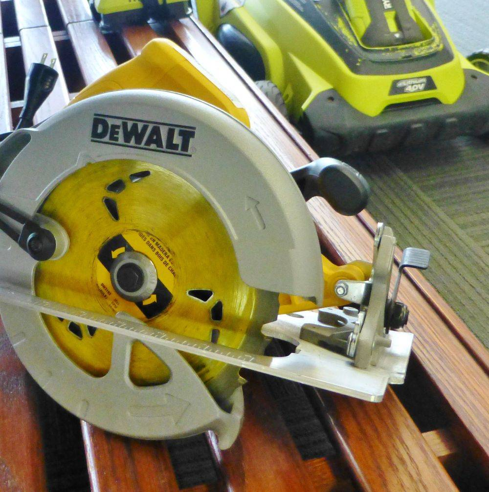Close up picture of a black and yellow corded DeWalt Circular saw