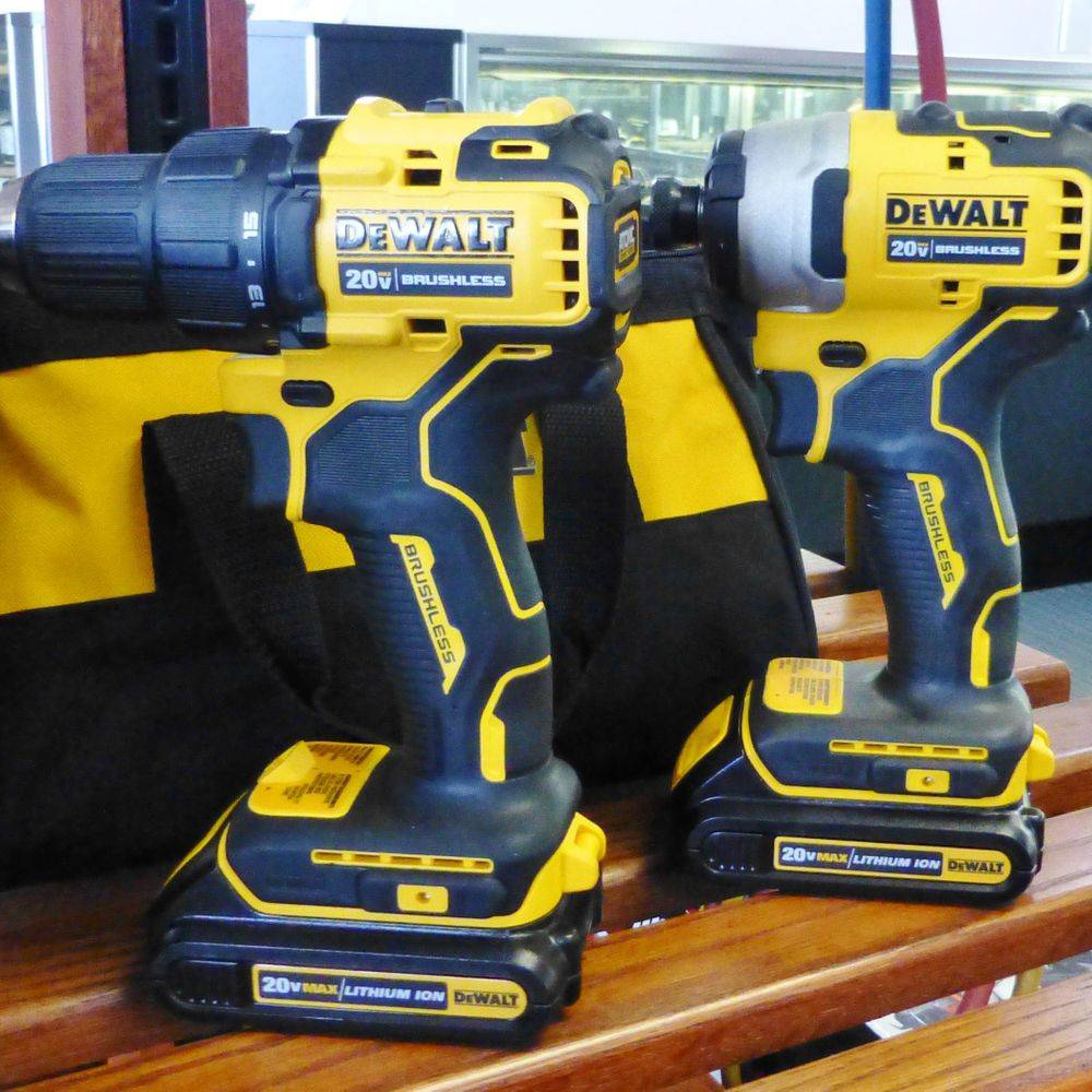 closeup picture of a black and yellow DeWalt 20V hammer drill and impact drill combo