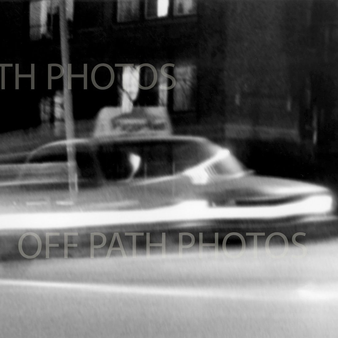 black and white photography, motion, cars, city, food delivery, night