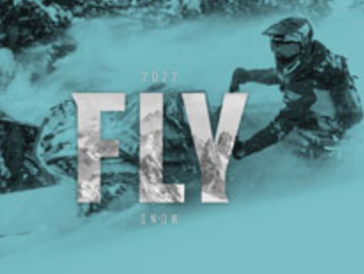 FLY Catalog with snowmobiler in deep powder snow