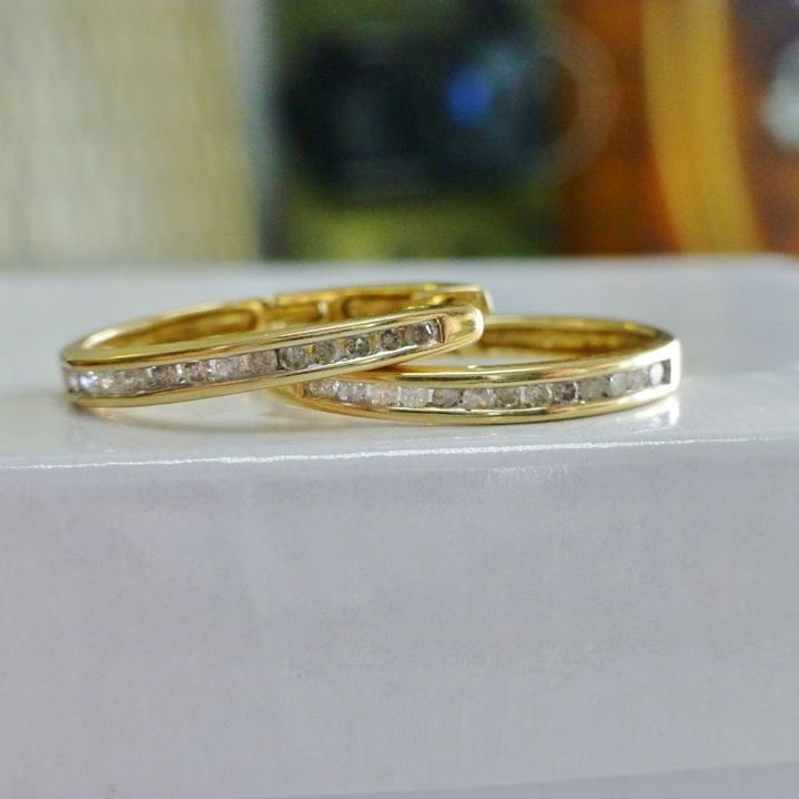 oval shaped yellow gold hoop earrings with channel set round cut diamonds