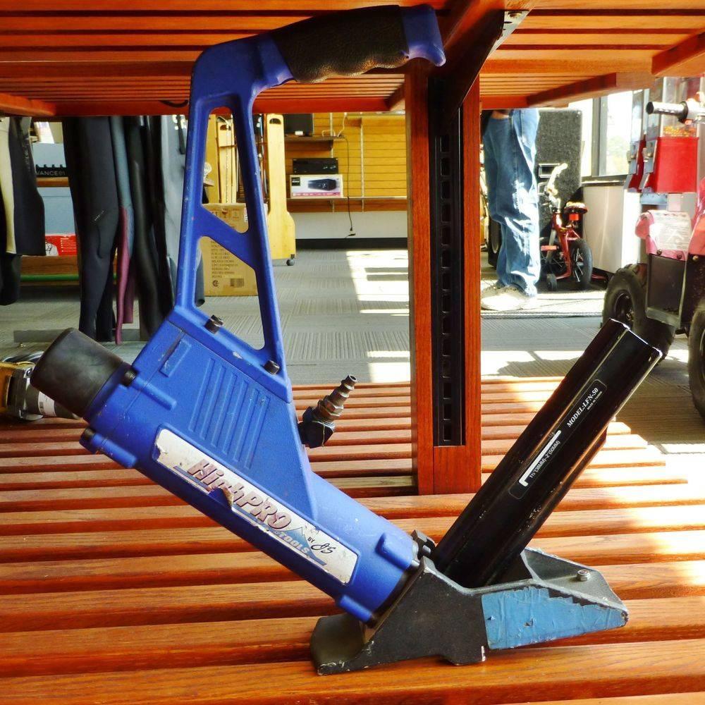 blue and black highpro flooring nailer on a wooder shelf