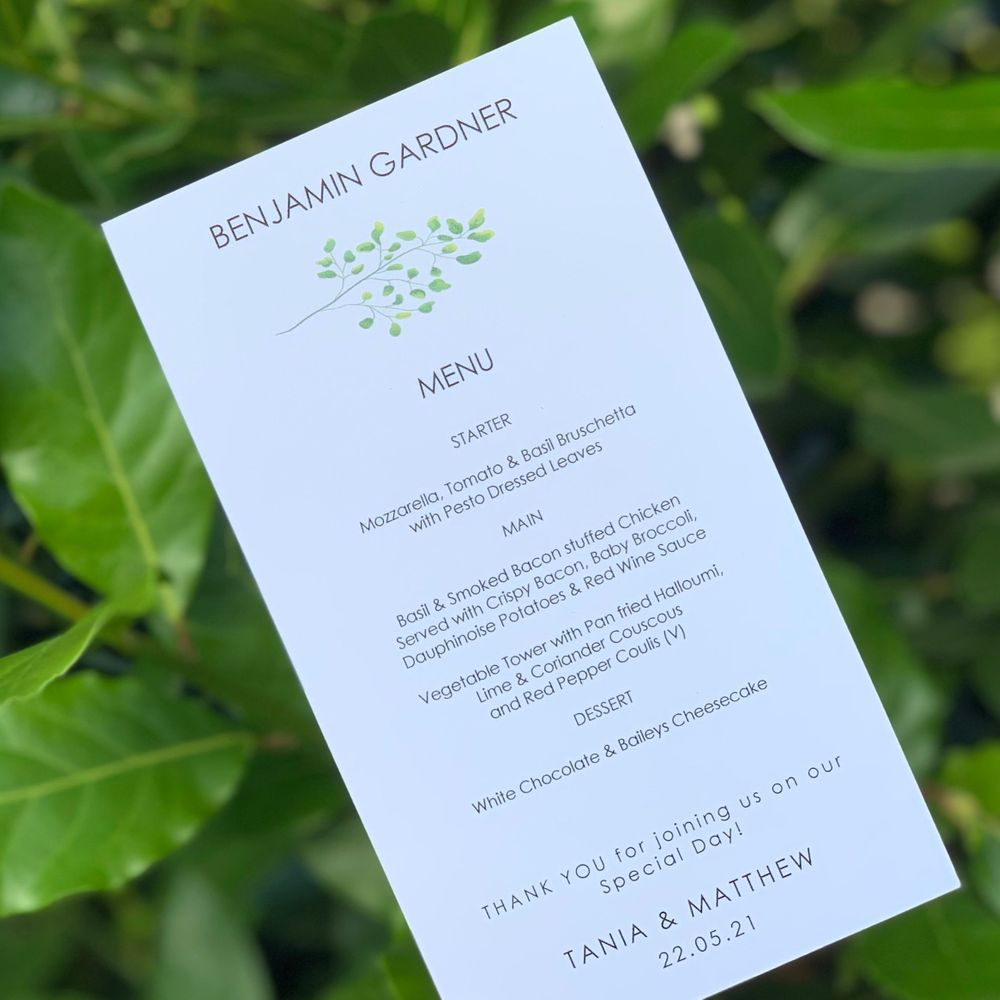 Wedding Menu with guest name in botanical theme in white with green leaves