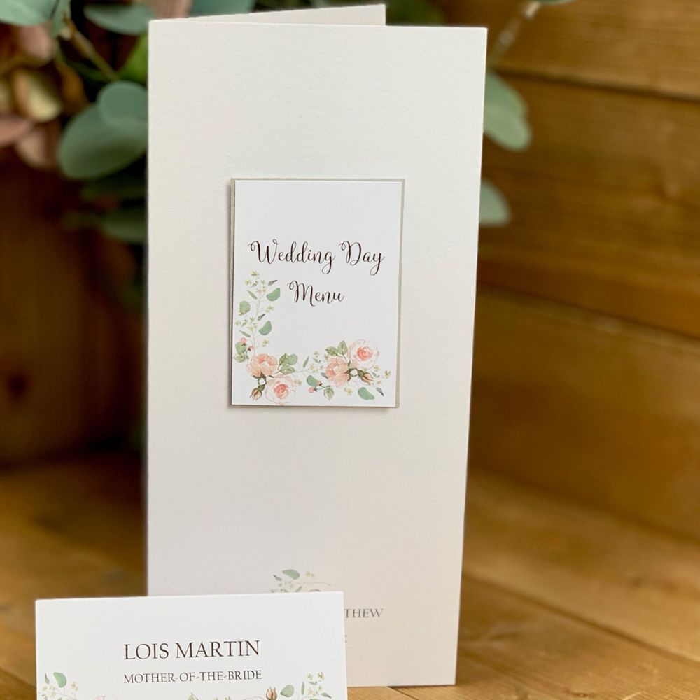 Menu card in white pale pink and sage green with silver border