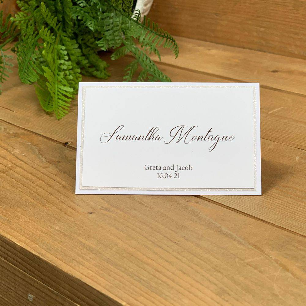 Wedding Place name in white with white glitter and printed guest name