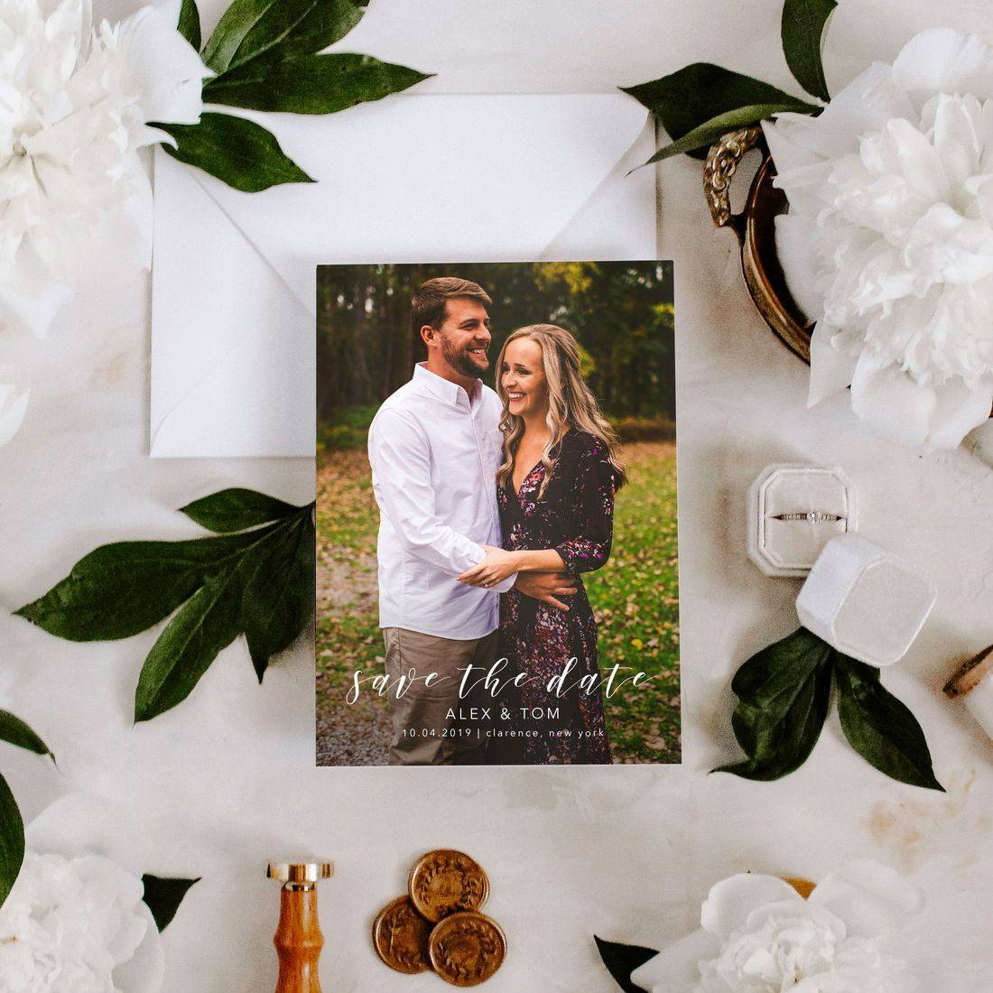 Engagement photo save the date flat lay with peonies
