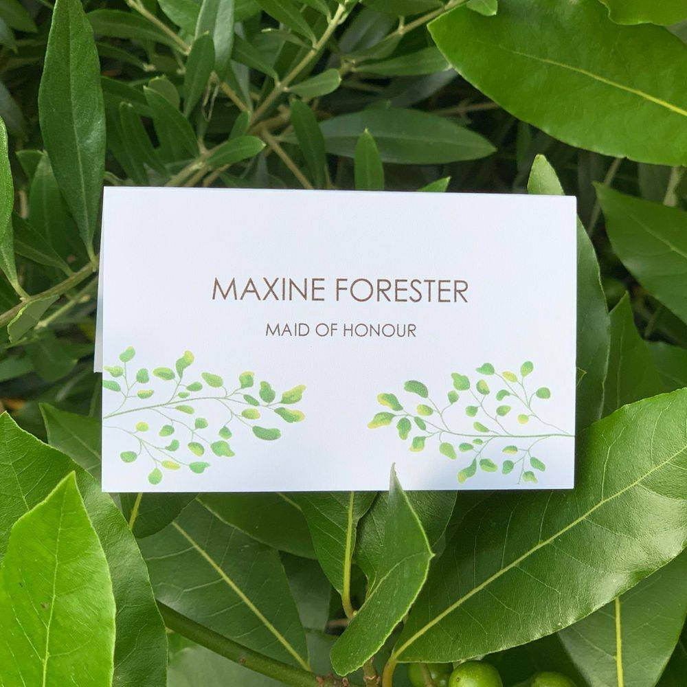 Wedding  place name in white with green leaves
