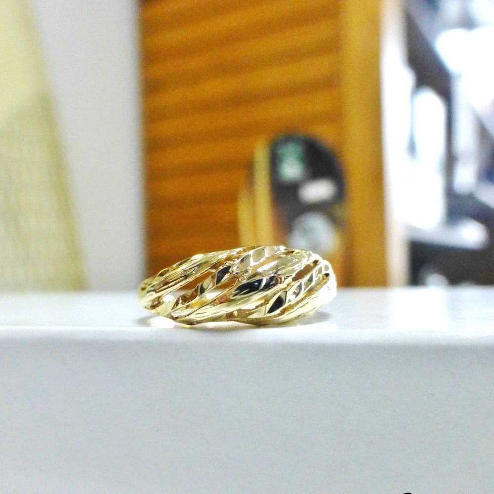 Yellow Gold Slanted Ribbing  Yellow Gold Ring on a White Surface