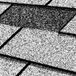 The protective granular surface of shingles wears off as the asphalt, into which the granules are embedded, begins to harden over time. Bare spots are often accompanied by fine fissures on the shingles' surface and by the accumulation of granules in the gutters.