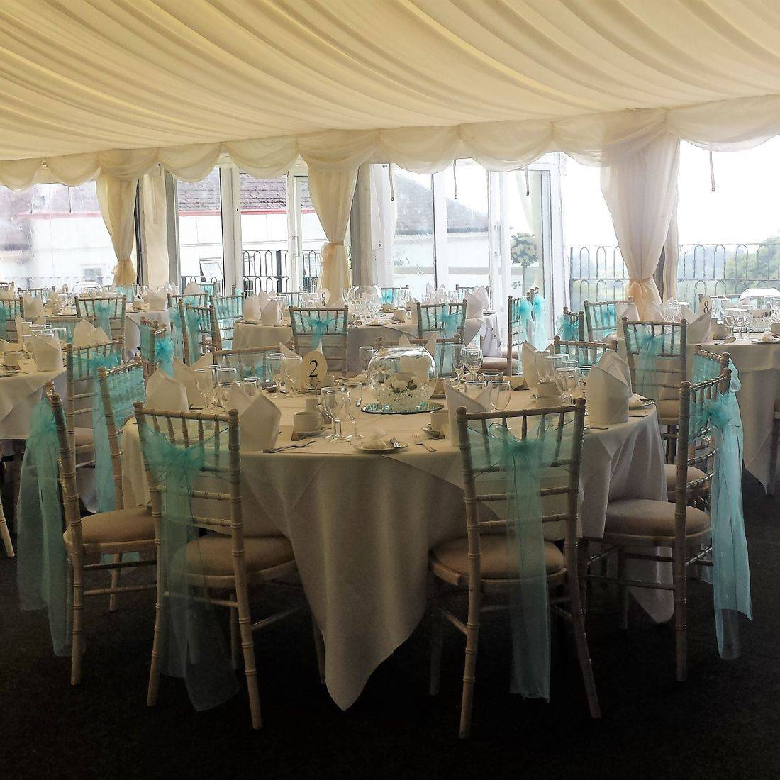 Chiavari Chairs with Turquoise Organza Sash