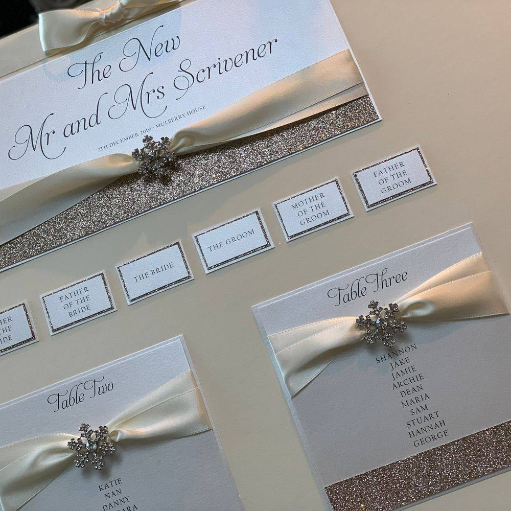 Christmas Wedding Table plan with crystal snowflake