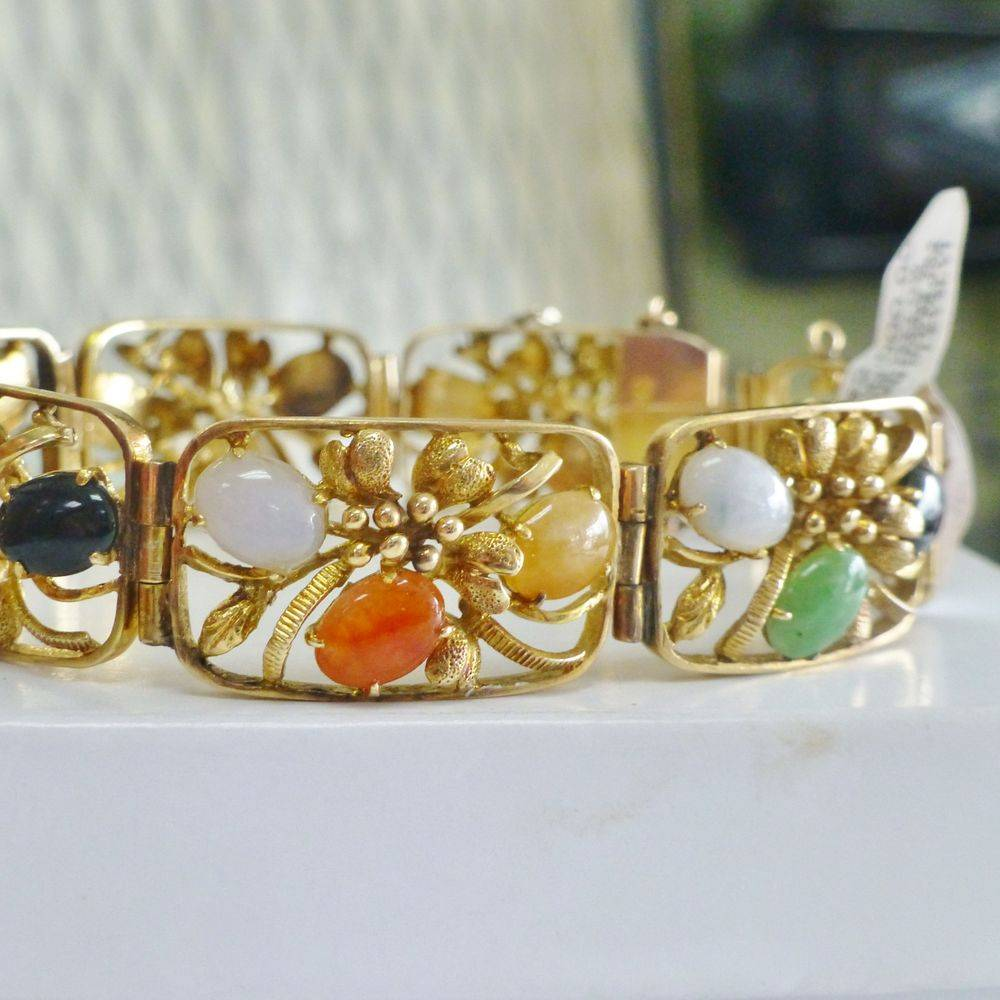 Multi Cabochon gemstones prong set in a yellow gold floral design box link bracelet