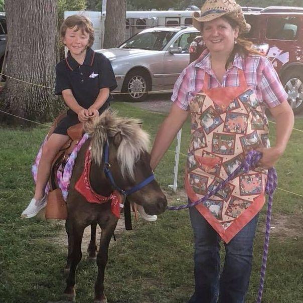 Little boy sitting on a pony