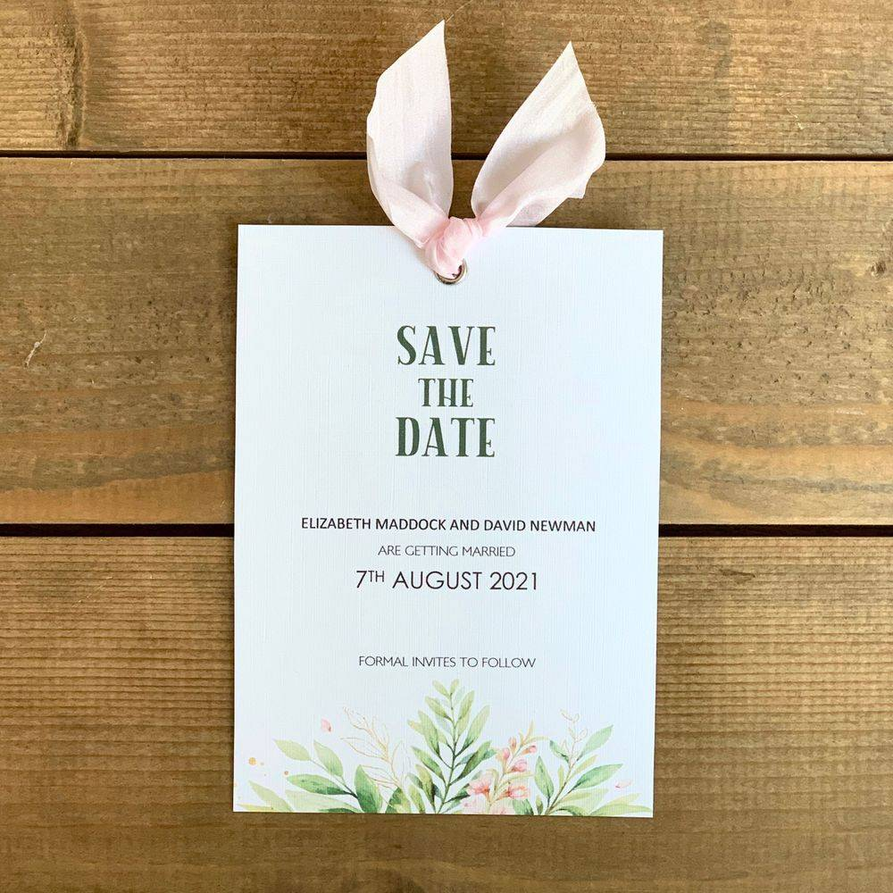 Pink and white save the date card with pink silk ribbon