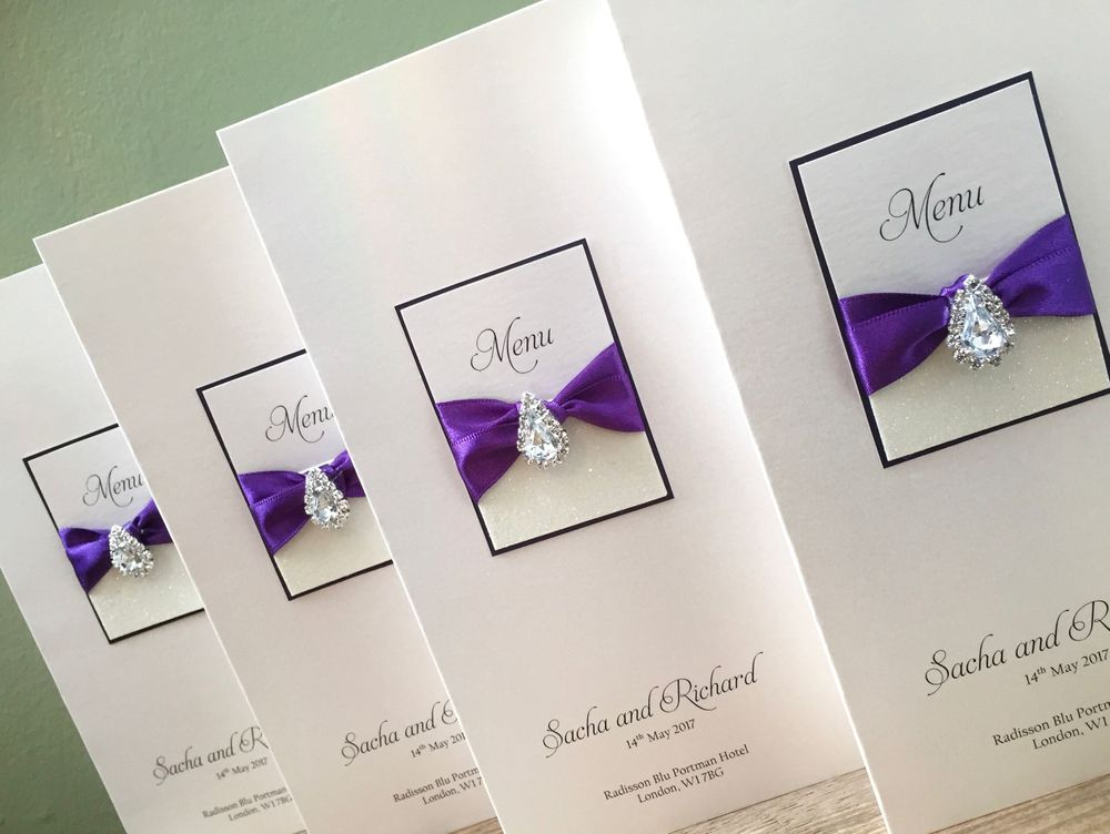 Menu card with guest name in white with silver glitter