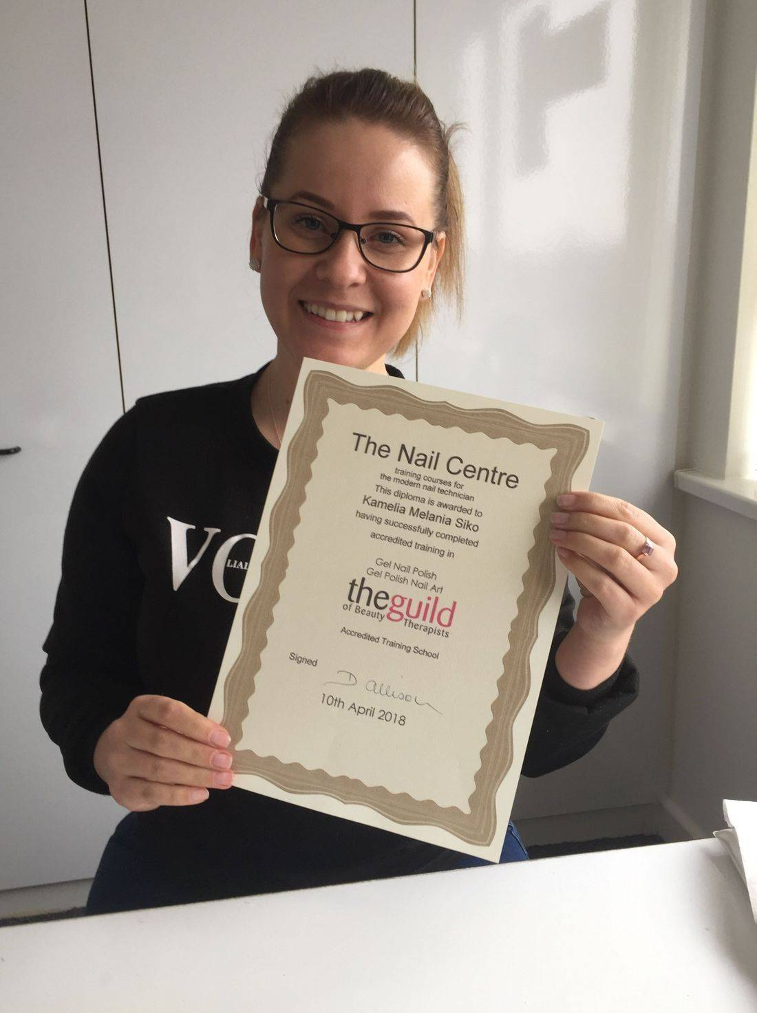 A happy qualified nail technician