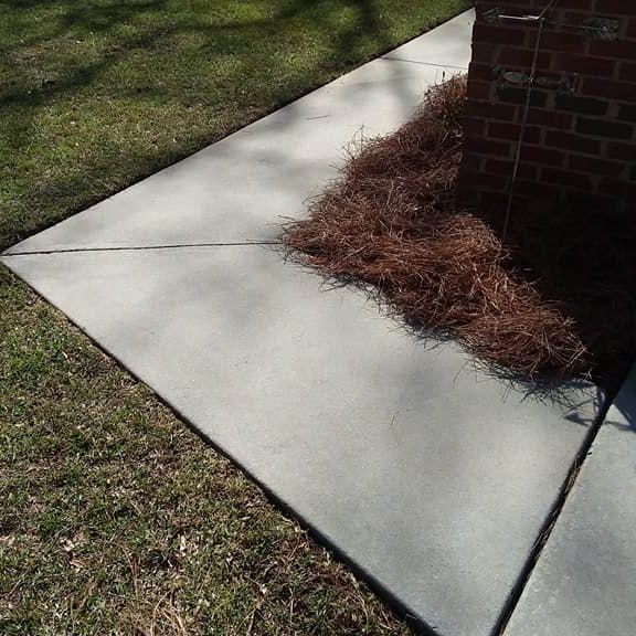 Pressure clean a sidewalk