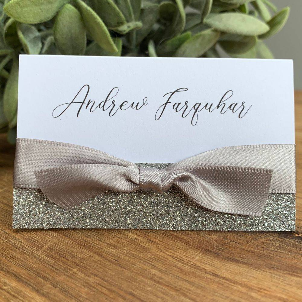 Wedding guest place name silver and white, silver glitter on white with silver grey ribbon