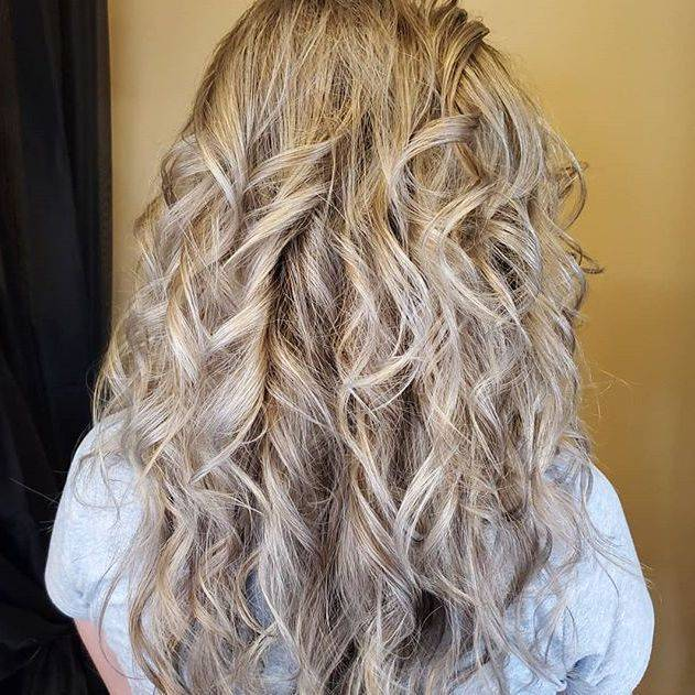 long blond hair with long layers. full babylight foils .. toned to remove brassyness.. curled style
