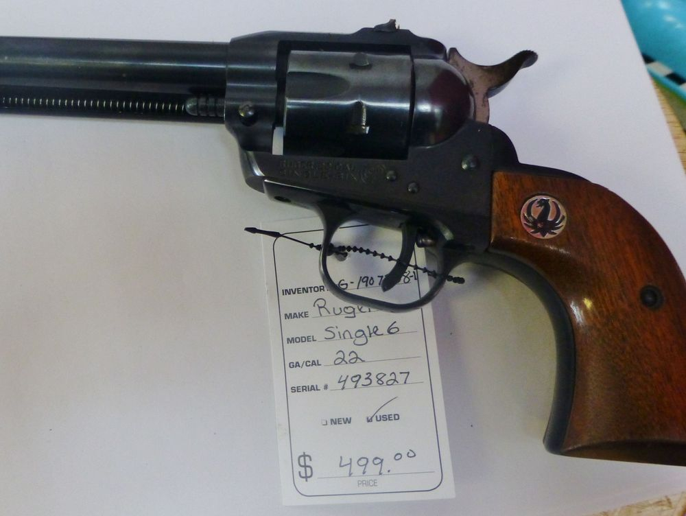Black and Brown Ruger 22 Cal Revolver with Sales tag