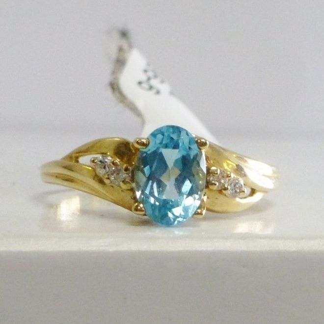 14K Yellow Gold Ring With  Prong Set Oval Cut Swiss Blue Topaz Center and Round Side Diamond Accents