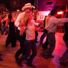 Beginners learn to country dance two step.