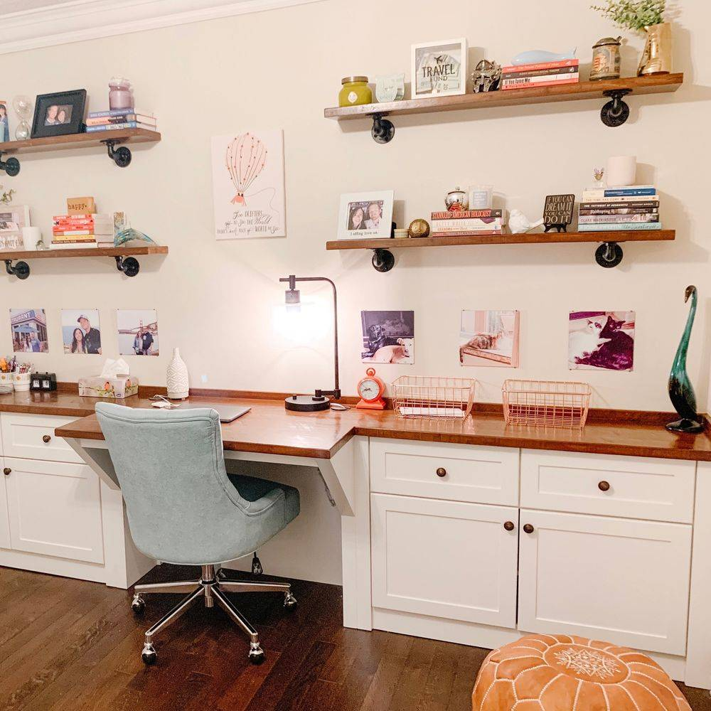 Built in desk with open concept industrial gas pipe shelving