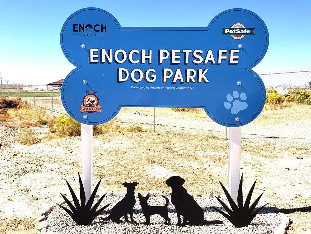 Blue dog bone shaped sign, Enoch Petsafe Dog Park