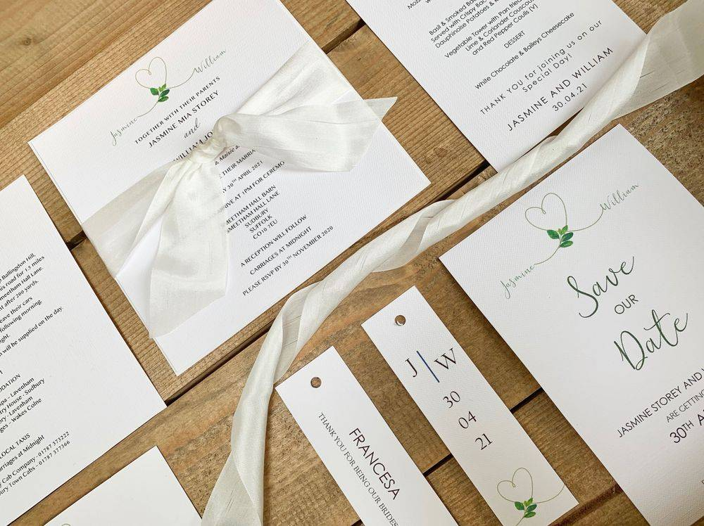 Luxury personalised wedding stationery in white with white silk ribbon