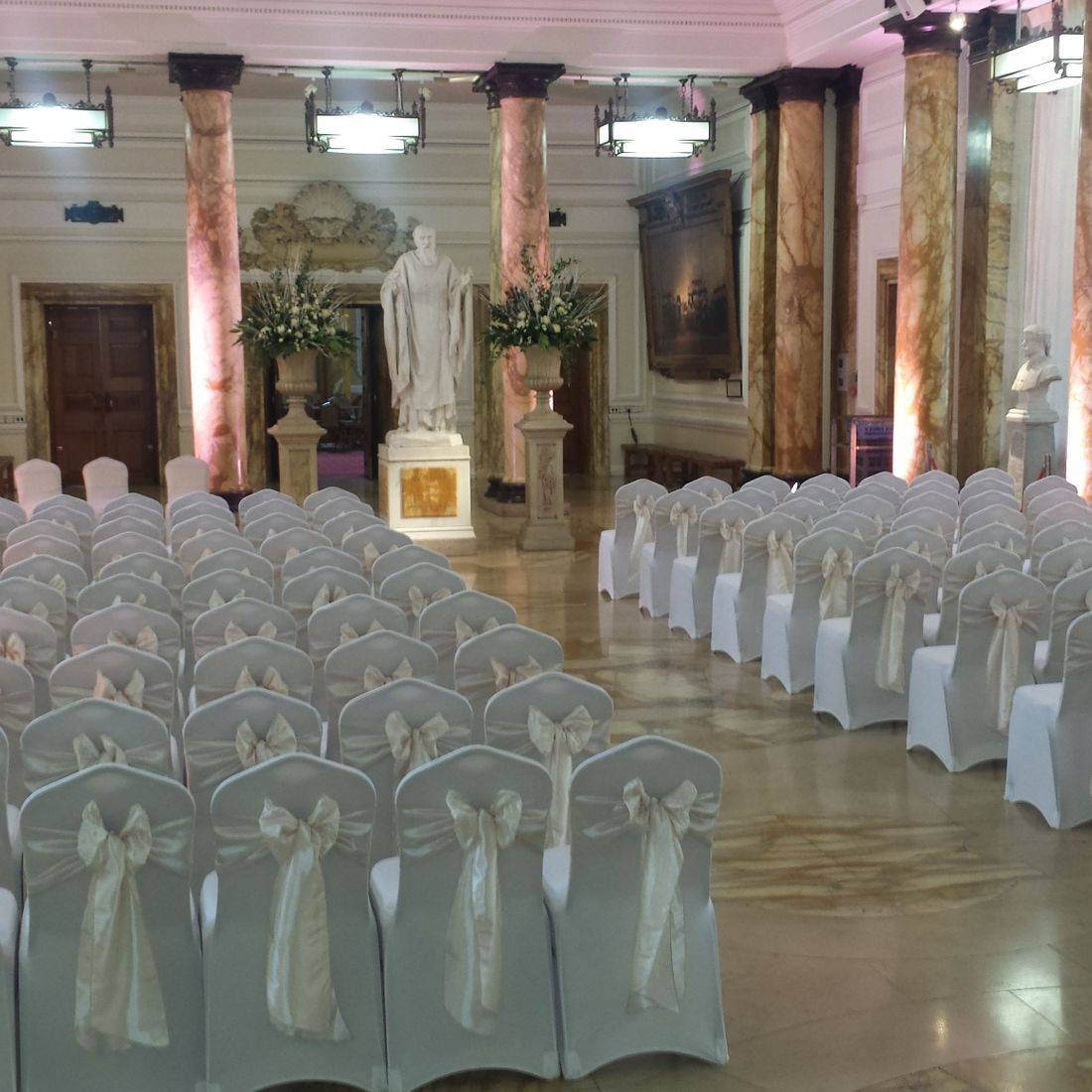 White Chair Covers with Champagne Sash