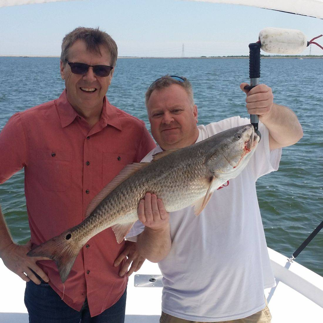 Friends, down to do some fishing, Redfish fishing at Brauning can be awesome. The schools are and challenging but rewarding. Fishing for Redfish in our San Antonio, Texas local lakes. Bones Fishing Guide Service provided an amazing fishing trip on the water and putting his clients on some Redfish.