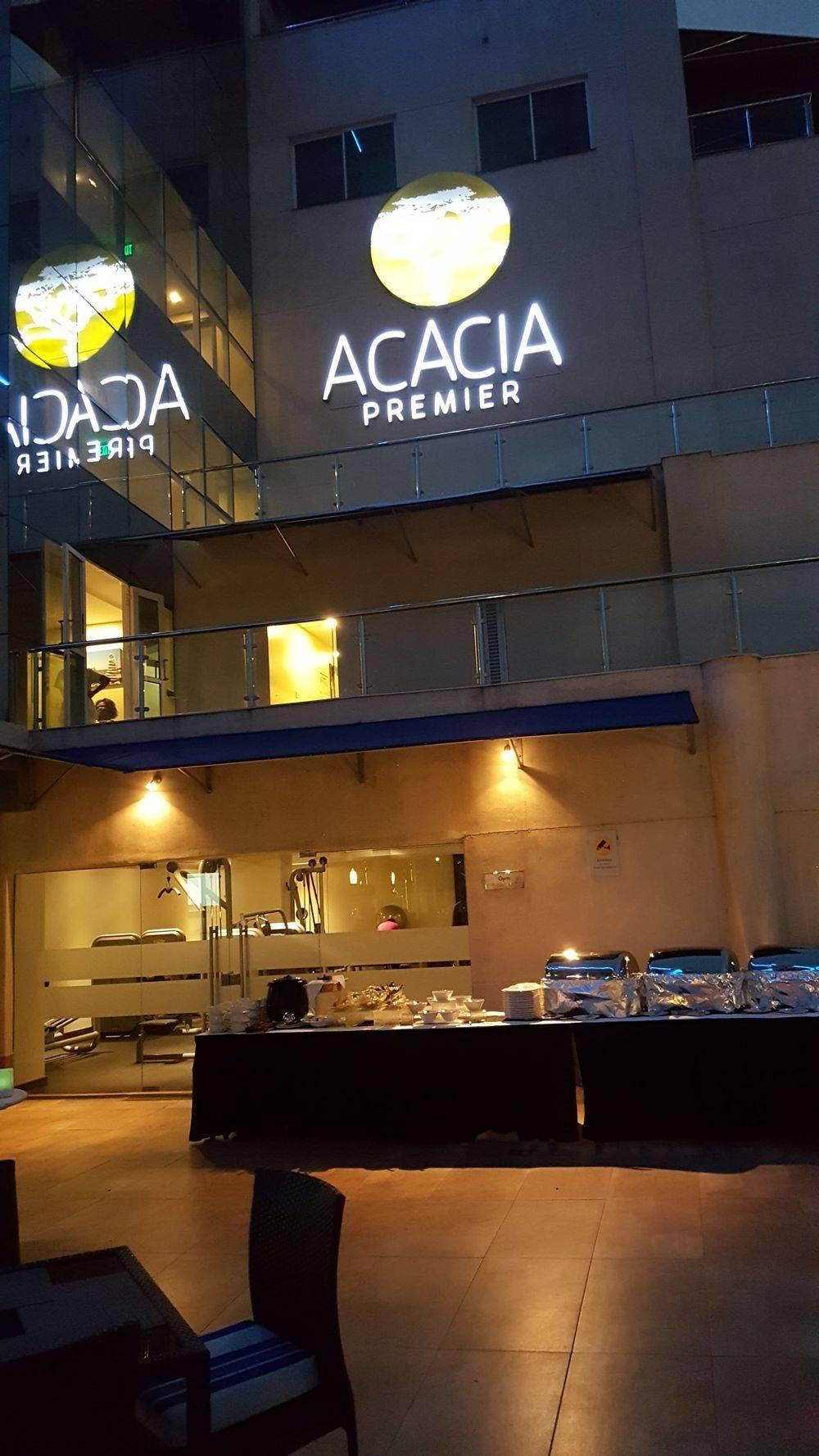 rooftop bar in acacia premier kisumu kenya , acacia premier hotel kisumu kenya  , mountains outside kisumu kenya , tusker beer , kisumu lakeside restaurant , kisumu international airport kenya , british & far east traders , welcome to kenya , kenya africa