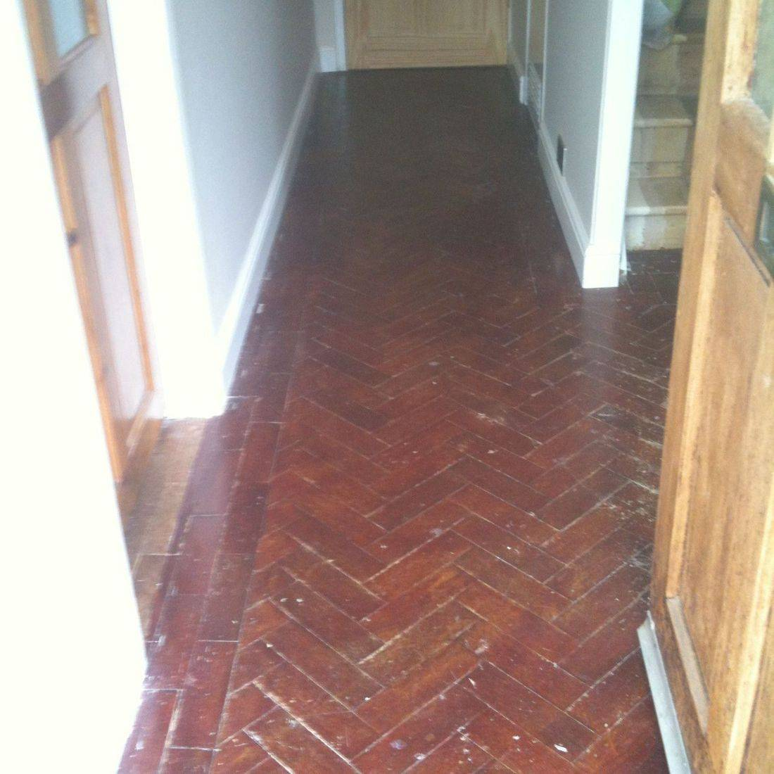 Oak Flooring in Hallway before sanding and sealing